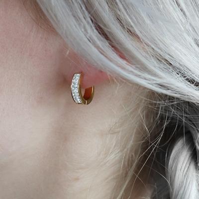Stalen oorbellen goldplated wit kristal