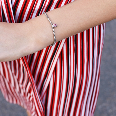 Stalen armband bol/hart roze kristal
